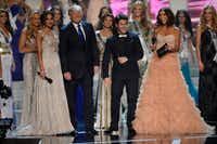 From left: Miss Universe 2012 Olivia Culpo, Donald Trump, recording artist and host Nick Jonas and television personality and host Giuliana Rancic appeared onstage during the Miss USA 2013 pageant in Las Vegas. (File Photo/The Associated Press)