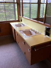 Original twin sinks and built-in cabinetry in an upstairs bathroom at the O'Neil Ford-designed Penson house.(Alan Peppard/Staff writer)
