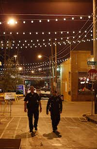 Police who were working a private event in Deep Ellum walk the streets in Dallas, TX Sept. 27, 2016. (Nathan Hunsinger/The Dallas Morning News(Staff Photographer)