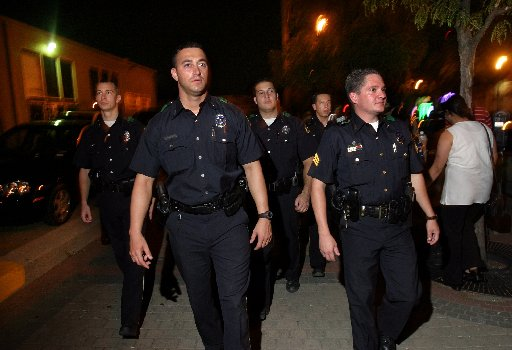 Dallas officers walk the streets of Deep Ellum on August 23, 2003 after Mayor Laura Miller promised a group of Deep Ellum business owners she would have a police officer on every corner of Deep Ellum on weekend  nights to help put an end to growing incidents of crime in the area. (Dallas Morning News file photo)