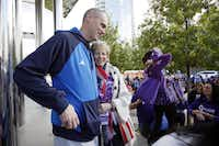Mitchell embraced Dallas Mavericks head coach Rick Carlisle following his talk at a 5K benefiting pancreatic cancer research in 2014. After being diagnosed with the disease and undergoing successful surgery, Mitchell campaigned to raise awareness.(Ben Torres/Special Contributor)