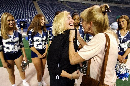 Mitchell (right), who directed the squad through the peak of its popularity, playfully clutches Suzy Roberts, one of her former cheerleaders, at a 2002 reunion celebrating the team's 30th anniversary at Texas Stadium. <br>File photo<br>