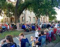 On an August Friday night, hundreds gather on the lawn of the Williamson County Courthouse in Georgetown to hear a jazz combo play, despite the heat. (Helen Anders)