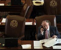 "<p><span style=""font-size: 1em; background-color: transparent;"">State representative Dan Flynn, R-Canton, works the phones during a break in the Sunday session for the 83rd Texas legislature at the State Capitol in Austin on Sunday, May 26, 2013. (Louis DeLuca/The Dallas Morning News)</span></p>"
