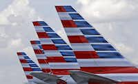 Tails of four American Airlines passenger planes parked at Miami International Airport.(Alan Diaz/Associated Press)