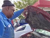 Jeff Fleming looks at Toni Brown's car, which he has kept for 19 months without repairing.Dave Lieber/Staff
