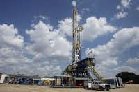 """A drilling rig operates in the Barnett Shale in Flower Mound, Texas, on July 19, 2010.(<p><span style=""""font-size: 1em; background-color: transparent;"""">Kye R. Lee/The Dallas Morning News</span><br></p><p></p>)"""