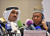 "In this photo dated Wednesday, Sept. 28, 2016, acting Secretary General of OPEC Mohammed Barkindo, right, looks at Minister of Energy and Industry of Qatar, Bin Saleh Al-Sada, during a closing press conference at the end of meeting of oil ministers of the Organization of the Petroleum Exporting countries, OPEC, in Algiers, Algeria. OPEC nations reached a preliminary agreement Wednesday to curb oil production for the first time since the global financial crisis eight years ago, in an effort to reduce a global glut of crude that has depressed oil prices for more than two years and weakened the economies of oil-producing nations.&nbsp;(<p><span style=""font-size: 1em; background-color: transparent;"">AP Photo/Sidali Djarboub</span></p>)"
