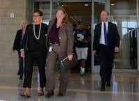Christina Morris' mom, Jonni McElroy, walks into the lobby of the courthouse with Robyn Busby, the Plano Police Department's lead detective on the Arochi case.