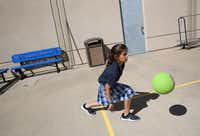 Fourth-grader Elisheva Wider plays near the Buddy Benches at Akiba Academy in North Dallas.(Rose Baca/Staff Photographer)
