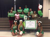 Jordin Phipps, 8, was surrounded by her family and UNT cheerleaders at her Garland school, the Watson Technology Center for Math & Science, after she learned she was accepted to the university.