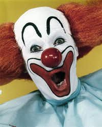 Larry Harmon portrays Bozo the Clown, whose mission was making kids smile, not terrifying them.  (The Associated Press)<div><br></div><div><br></div>