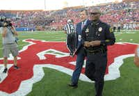 Dallas Police Chief David Brown conducts the coin toss as Texas Christian visits Southern Methodist at Gerald J. Ford Stadium in Dallas on Friday, Sept. 23, 2016. (Max Faulkner/Fort Worth Star-Telegram/TNS)(TNS)