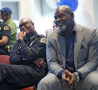 Dallas Police Chief David Brown and Dallas Cowboys legend Emmitt Smith shared a laugh during an appreciation event for officers at the Dallas Police Headquarters in August.  (Nathan Hunsinger/The Dallas Morning News)(Staff Photographer)