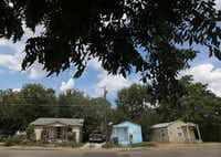 Three houses on Nomas Street in West Dallas, all owned by HMK.((Louis DeLuca/Staff Photographer))