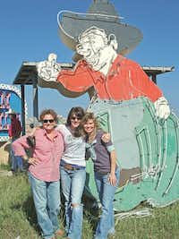 What will the Junk Gypsies do with their 12-foot neon cowboy? Who knows, but they had to have it.