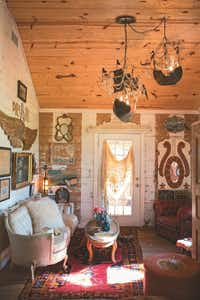 """Vaulted ceiling, ship chandeliers, angel wings, vintage carousel panel -- of course they all work together when you combine farmhouse style with whimsy, says Amie Sikes.(<p><span style=""""font-size: 1em; background-color: rgb(255, 255, 255);"""">A</span><span style=""""font-size: 1em; background-color: transparent;"""">pril Pizana Photography</span></p>)"""