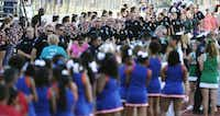 About 400 members of Texas law enforcement agencies marched into UT-Arlington's Maverick Stadium for Special Olympics Texas' opening ceremonies in late May. (Brandon Wade/Special Contributor)