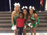 Jordin Phipps, 8, learned Sept. 29 that she's been pre-admitted to the University of North Texas. A group from UNT, including cheerleaders Bailey North (left), Nikki Dinh and Sydney Minor, went to Jordin's school, the Watson Technology Center for Math & Science in Garland, to bring her the news.