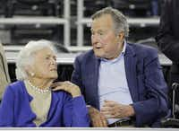 Former Republican President George H.W. Bush, with wife Barbara, reportedly said last month he plans to vote for Democrat Hillary Clinton. (2015 File Photo/The Associated Press)