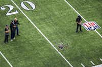 Javier Gutierrez (from left), Richard Cox, Ron Wingo and Taylor Ellis fly a drone around AT&T Stadium to test AT&T signal strength on Wednesday. They also flew a smaller, chaser drone that filmed the larger drone.(Ashley Landis/Staff Photographer)