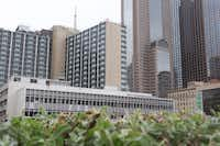 The former Dallas Public Library building (foreground) is part of a two-building, $221 million redevelopment in downtown Dallas. The adjoining Statler Hilton hotel building is slated to reopen, along with residences and retail, in 2017. (Irwin Thompson/Staff Photographer)