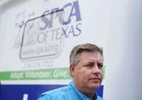 James Bias, SPCA of Texas president James Bias speaks with an employee at the nonprofit's mobile spay and neuter truck at the Umphress Recreation Center in Dallas on Thursday October 6, 2016. The truck is dedicated to serve southern Dallas. (Andy Jacobsohn/Staff Photographer)