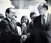 New Chief Justice William Rehnquist (right) shakes hands with the newest Associate Justice Antonin Scalia outside the Supreme Court Building in this 1986 photograph.