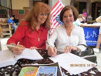 Judith Turner, a volunteer with Democrats Abroad in Mexico, helps a resident in San Miguel de Allende register to vote. (Marc Berube)
