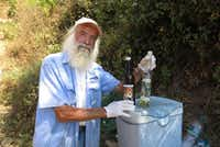 Eighty-year-old Angelo Celsi, one of just 4,000 residents within Italy's Cinque Terre, sells freshly squeezed lemon and orange juice along one of the park trails. (Amy Laughinghouse)