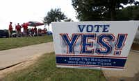 A sign of Vote Yes! Keep the Rangers is seen on Nolan Ryan Expressway as fans tailgate in the background before Game 1 of American League Division Series between Texas Rangers and Toronto Blue Jays at Globe Life Park in Arlington.(Jae S. Lee/Staff Photographer)