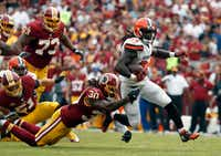 Washington Redskins strong safety David Bruton (30) tackles Cleveland Browns running back Isaiah Crowell (34) during the first half of an NFL football game Sunday, Oct. 2, 2016, in Landover, Md. (AP Photo/Carolyn Kaster)(AP)