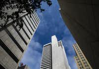 AT&T has four high-rise buildings at Commerce and Akard streets in downtown Dallas.(Ashley Landis/Staff Photographer)