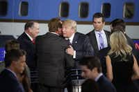 Arnold Schwarzenegger and Donald Trump share a hug at a Republican presidential debate at the Ronald Reagan Presidential Library in Simi Valley, Calif., on Sept. 16, 2015. Schwarzenegger was there as a spectator.(MAX WHITTAKER/New York Times)