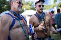 JayJay McCormick (left) and Ty Larson wore harnesses and medals as this year's Mr. Bear and Mr. Cub Round-up at Saturday's gay pride event. (Ting Shen/Staff Photographer)