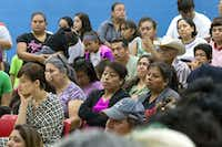 Community members listen to announcements during a community meeting regarding upcoming mass evictions in West Dallas by landlord HMK Ltd at Anita Martinez Recreation Center on Oct. 8, 2016 in Dallas. (Ting Shen/Staff Photographer)