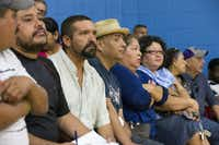 Community members listen to announcements during a community meeting regarding upcoming mass evictions in West Dallas by landlord HMK Ltd at Anita Martinez Recreation Center on Oct. 8, 2016 in Dallas.(Ting Shen/Staff Photographer)