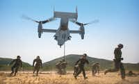 U.S. Marines evacuate the area as an MV-22B Osprey comes into land at Hat Yao, Thailand during Exercise Cobra Gold 2014. (U.S. Marine Corps photo by Cpl. Zachary W Scanlon)