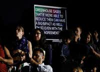 """<p><strong style=""""font-size: 1em; background-color: transparent;"""">A screen displayed what President Barack Obama, actor Leonardo DiCaprio and Dr. Katharine Hayhoe, a Texas Tech University climate scientist, were saying during a White House South by South Lawn discussion on climate change this month. (Carolyn Kaster/The Associated Press)</strong></p>"""