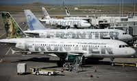 Frontier Airlines planes outside gates on the A concourse in Denver. ((AP))