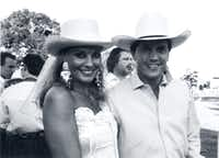 Pamela Graham and George Strait at the 1989 Cattle Baron's Ball where he performed on a dry, moonlit night. Two years later, lightning and rain kept him from playing.(DMN file/32133)