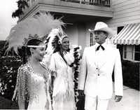 Larry Hagman wore his white, doe-skin tuxedo to the 1981 Cattle Baron's Ball where he posed with co-chairs Melinda Wynn and Frances Sheperd. Later in the evening, he was covered in mud.(File Photo/digital file)