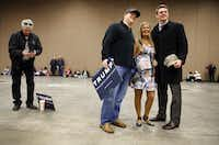 Barbara Tomasino of Plano posed for a photo in her Donald Trump dress with fellow supporters Jeff Schroeder of Frisco (left) and Teague Morton of Dallas. (Tom Fox/Staff Photographer)