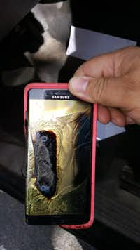 This Friday, Oct. 7, 2016, photo provided by Andrew Zuis, of Farmington, Minn., shows the replacement Samsung Galaxy Note 7 phone belonging to his 13-year-old daughter Abby, that melted in her hand earlier in the day. (Andrew Zuis via AP)(AP)