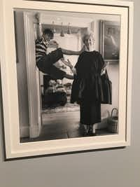 At the Bruce Weber exhibit at Dallas Contemporary, a photograph by Bruce Weber of the Duchess of Devonshire modeling couture clothing as her great grandson vamps in the doorway(Rick Brettell)