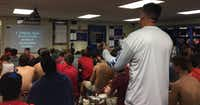 "Head coach Randy Jackson talks to the Grapevine High School football team about recently revealed audio of Donald Trump making lewd comments about women. Trump said the comments were just ""locker room talk,"" but Jackson said his language was unacceptable.(Charles Scudder/Staff Writer)"