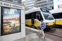 A teen recently rushed to board a DART Blue Line train headed toward Ledbetter at the St. Paul Street station.(Ting Shen/Staff Photographer)