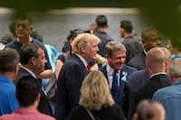 Republican Presidential Candidate Donald Trump, center, speaks with Rep. Michael McCaul, R-Texas, right, as he attends a ceremony at the National September 11 Memorial, in New York, Sunday, Sept. 11, 2016. (AP Photo / Andrew Harnik)