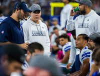 Dallas Cowboys quarterback Tony Romo (9) talks to quarterback Dak Prescott (4) after Prescott was sacked during the third quarter of their game against the Cincinnati Bengals on Sunday, October 9, 2016 at AT&T Stadium in Arlington, Texas. (Ashley Landis/The Dallas Morning News)(Staff Photographer)