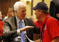 Sen John Cornyn talks with GOP party chairman Tom Mechler, at the Republican National Convention.(Vernon Bryant/Staff Photographer)